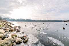 Frozen lake with rocks Royalty Free Stock Images