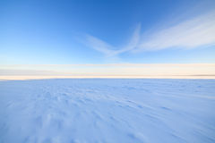 Frozen lake scape and blue sky Royalty Free Stock Image