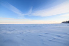 Frozen lake scape and blue sky Royalty Free Stock Photos