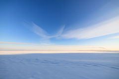 Frozen lake scape and blue sky Royalty Free Stock Images