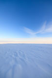 Frozen lake scape and blue sky Stock Photo
