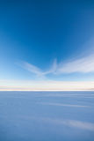 Frozen lake scape and blue sky Stock Image