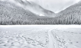 Frozen Lake with Sled Trail in Mountains Royalty Free Stock Image