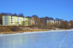 Frozen lake and a small town Royalty Free Stock Photo