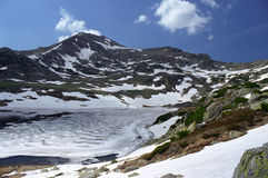 Frozen lake on spring. Frozen lake Bucura on springtime Stock Images
