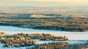 Frozen lake and spruce forest in winter. Finland, Ruka stock photos