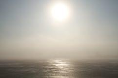 Frozen lake and sunlight Stock Image