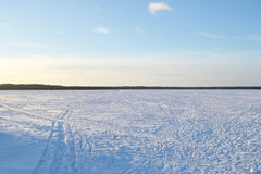 Frozen lake at sunny winter day. Royalty Free Stock Images