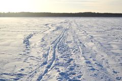 Frozen lake at sunny winter day. Stock Images