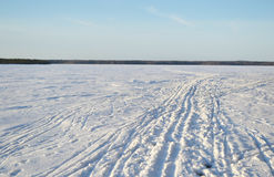 Frozen lake at sunny winter day. Stock Image
