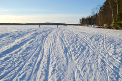 Frozen lake at sunny winter day. Stock Photography