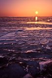 Frozen lake and sunset Stock Images