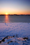 Frozen lake at sunset Royalty Free Stock Photos