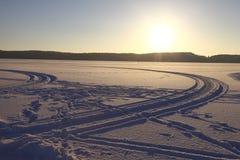 Frozen lake sunset Stock Photo