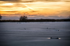 Frozen lake at sunset Royalty Free Stock Image