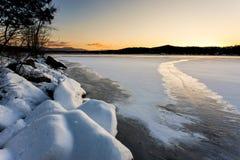Frozen Lake at sunset. Stock Photo