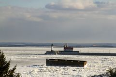 Lake Superior with The Crib and lighthouses, Duluth, MInnesota. Frozen Lake Superior shoreline with The Crib, lighthouses and shipping pier in Duluth, Minnesota stock images