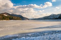 Frozen lake surrounded by the forest Royalty Free Stock Photography