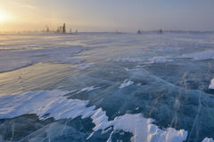 Frozen lake on Tundra. Frozen lake with boreal forest (taiga) and tundra in background at Wapusk national park, Canada, during blizzard Royalty Free Stock Photography