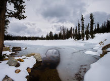 Frozen Lake in the Uintas of Utah. This photo was taken near the Mirror Lake highway in Utah in May of 2015 Stock Images