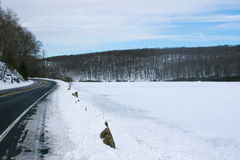 Frozen lake at upstate New York. Bear Mountain Park landscape during winter Royalty Free Stock Photography