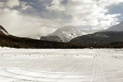 Frozen lake used as a piste in the snowy alps in st moritz alps switzerland in winter Stock Image