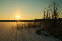 Frozen Lake. View of the sunset over the frozen lake Royalty Free Stock Photography
