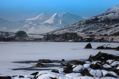 Frozen lake - and view to Snowdon. Winter white Snowy scenes around Snowdonia National Park North Wales UK Stock Images
