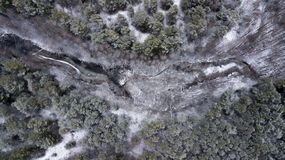 Frozen lake in the winter forest. Aerial photography with quadcopter royalty free stock photo