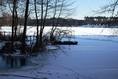 Frozen lake. Winter landscape with lake covered with ice Royalty Free Stock Photos