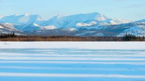 Shadows in the frozen lake at morning. Winter landscape on the mountains and the frozen lake. royalty free stock photos