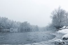 Frozen lake in winter, Winter lake scene reflecting in the water. Nature stock photography