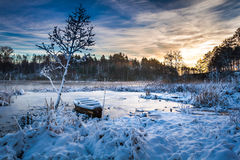 Frozen lake in winter at sunrise Stock Photo