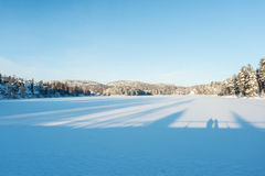 Frozen lake in winter. At sunset Stock Photography