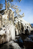 Frozen lakefront rock cliff Royalty Free Stock Image