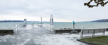 Frozen lakeside promenade. Panoramic view of Geneva lakeside promenade covered with ice further to a winter storm royalty free stock photo