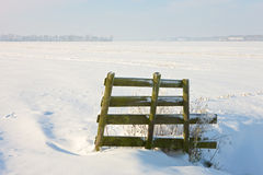 Frozen landcape with small gate. A sunny winter day in Dutch landscape Stock Images