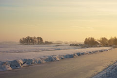 Frozen landcape at sunset. A winter day in Dutch landscape at sunset Royalty Free Stock Image