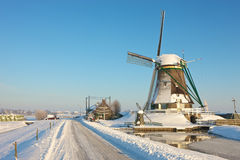 Frozen landcape with windmill. A sunny winter day in Dutch landscape with windmill Royalty Free Stock Photos