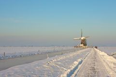 Frozen landcape with windmill. A sunny winter day in Dutch landscape with windmill Stock Image