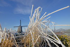 Frozen landscape with mill Stock Photography