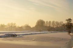 Frozen landscape at sunset. A sunset winter day in Dutch landscape Royalty Free Stock Photo
