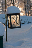 Frozen lantern near on a graveyard Stock Photo