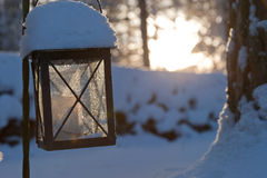 Frozen lantern near on a graveyard Royalty Free Stock Photo