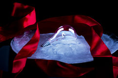 Frozen light. Light bulb in ice with red ribbon stock photos