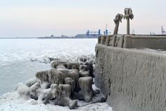 Frozen light poles. Next the Casino from Constanta, very much ice around Royalty Free Stock Images