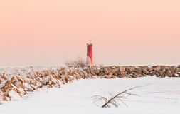 Frozen Lighthouse at Dusk, winter landscape scene Stock Image