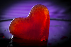 Frozen little red heart. Melting Royalty Free Stock Image