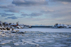 Frozen Lofoten's landscape. Icy sea near the Lofoten's village of Ballstad royalty free stock photo
