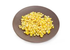 Frozen kernels of sweet corn on the brown dish Royalty Free Stock Image